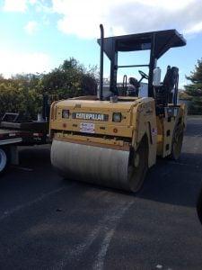 avoiding pavement steam roller asphalt scams
