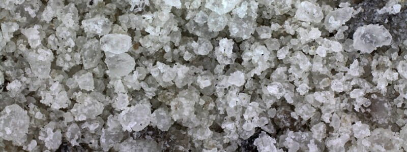 How does rock salt and deicer affect asphalt?