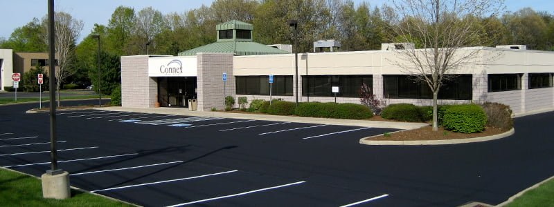 Parking lot repair and maintenance increases value