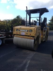 avoiding pavement steam roller asphalt scams