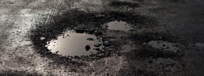 what causes potholes
